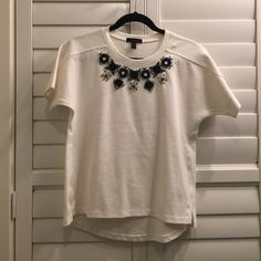 J. CREW Cream & Navy Necklace Top Beautiful cream top with navy jeweled details around the neckline. Never worn. Excellent condition. Machine wash cold. J.CREW Fall 2014 $88 STRUCTURED NECKLACE T-SHIRT Top-Ponte-NAVY Jewels-Size XS! J. Crew Tops Blouses