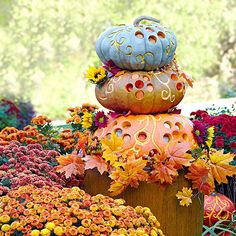 We love this whimsical pumpkin stack! Learn how to make it here: http://www.bhg.com/halloween/outdoor-decorations/outdoor-halloween-decorating-with-pumpkins/#page=16