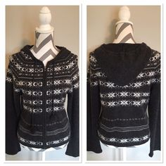 Cabela's Sweater 🎉HP🎉 100% lambs wool sweater. Zips up the front. Hooded with little pom poms on end of ties. Dark grey with white and lite grey snowflake look. Sweater has fuzzy look it is not piling!! Only worn a couple of times! 23 in long. Bust 16 in across. Dry Clean Only!! 🎉Host Pick Weekend Wardrobe @lauras_boutique go check her fabulous closet! Cabela's Sweaters