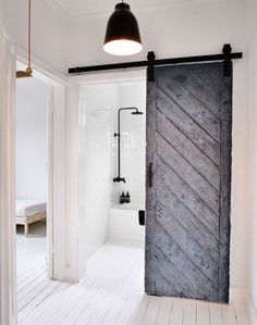 barn door used to close off shower. I like this maybe with kitchen cabinets stained charcoal stain.