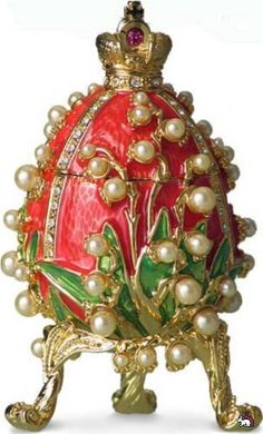 Faberge Egg with red and green enamel. Diamonds and pearls.