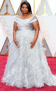 2017 Academy Awards: Octavia Spencer wears custom silver Marchesa with a satin off-the-shoulder bodice and feather skirt, plus shimmering jewels.