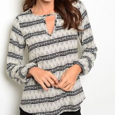 """BLACK IVORY AND GREY TOP Great patterned stripe print on this top and the detail at the neck. I love the elastic at the wrists. This top just speaks to me! 100% polyester. Silky. Length 27.25"""" Bust 18.25"""" Waist 20.25"""".  M - 1 NO PAYPAL NO TRADES. Due to Poshmark's commission, price is FIRM unless bundled. All sales final. Tops Blouses"""