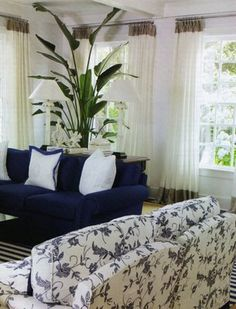 Blue and white living room - add a patterned couch to existing navy one? - My Dreamy Interiors Coastal Living Rooms, My Living Room, Home And Living, Living Room Decor, Blue Rooms, White Rooms, White Walls, Floral Couch, Blue Couches