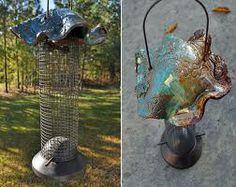 Google Image Result for http://images.fineartamerica.com/images-medium-large/pottery-wire-bird-feeder-amanda-spiers.jpg
