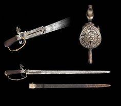 A double barrel flintlock sword pistol by H. W. Mortimer of London, 18th century.
