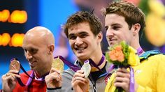 Gold medallist Nathan Adrian of USA poses with his medal Bronze medallist Brent Hayden of Canada, gold medallist Nathan Adrian ofUSAand silver medallist James Magnussen of Australia pose with their medalsfor the men's 100m Freestyle on Day 5 of the London 2012 Olympic Games at the Aquatics Centre