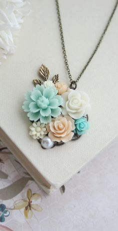 Mint, Peach, Aqua Blue, Ivory, Pearl, Brass Leaf Sprig Flower Collage Necklace. Maid Of Honor, Bridesmaids Gift, Peach Mint Rustic Wedding. https://www.etsy.com/listing/198400966/mint-peach-aqua-blue-ivory-pearl-brass?ref=shop_home_active_14&ga_search_query=peach