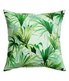 Mint green. Cushion cover in woven cotton slub fabric with a printed palm-leaf pattern. Concealed zip.