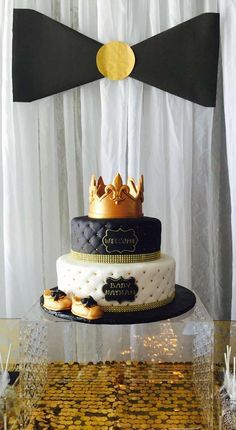 The prince crown topped cake at this Bow Ties Baby Shower is amazing!! See more party ideas and share yours at CatchMyParty.com #cake #babyshower