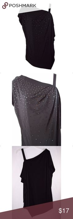 LANE BRYANT 18/20, 22/24 Studded Top Black in color with metal studs in the front, asymmetrical draped neckline, left arm Cold Shoulder can be worn in or out of sleeve, left arm has shoulder strap, overlay in front with asymmetrical hem, soft silky fabric is 95% polyester, 5% spandex, machine washable. Part of the brand name label is marked out to prevent retail store returns. Measurements: 18/20-bust 48 to 56. 22/24- bust 50 to 58. NWOT Lane Bryant Tops Tank Tops