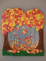 Falling Leaves Paper Craft Project for Kids | Here's what you'll need: • Printed Falling Leaves Template*  • Construction paper  • Sandwich-size zip-lock baggie  • Hole punch (optional)  • Pencil  • Scissors  • Glue  • Markers or crayons