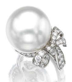 Marie Poutine's Jewels & Royals: Pearly Rings A pearl and diamond bow ring.