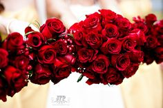 red bridal bouquet, red bridesmaid flowers, red and gold wedding