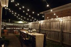 Two words: globe lights. | 20 Foolproof Hacks For Throwing The Perfect Dinner Party