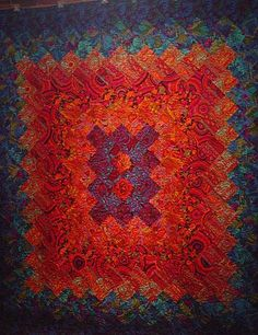 Kaffe Fassett Dancing Leaves quilt. The man has an excellent eye. Extraordinary, really.