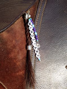 "The ""Natalie"" style keychain is a 4-strand rope braid with a decorative strand of beading along with a strand of circle beads with your horse's name on it. There are many different variations of this keychain, so please do not hesitate to ask for the specifics that you want."