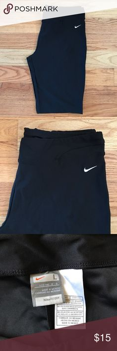 "Nike Workout Shorts Black Nike Workout/Bike shorts. Worn maybe once so they are in perfect condition! Size LARGE and they come down about mid thigh. Spandex/Polyester. (Inseam 11"") Nike Shorts"