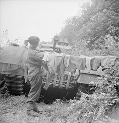 Hanging out the washing on a Churchill tank of 'B' Squadron, 107th Regiment Royal Armoured Corps, 34th Tank Brigade. Normandy, 17 July 1944.