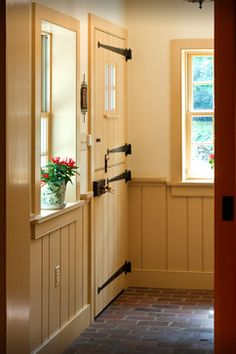 Dutch door ... Would love this on the garage door with screen door on also to keep flies and bugs out but light in.