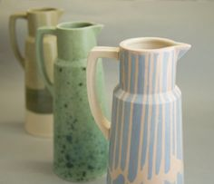 Modern pitcher made of stoneware created using colour-slip technique, covered with transparent glaze.  The jug covered with transparent glaze and