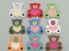 Lot of 9 Large Crochet Teddy bear Appliques    Quantity: 9    Color: 1 each of 9 colors shown in picture    Size: approx. 2 5/8(W) x 2 1/2(H)    Great