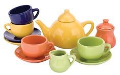 The porcelain set comes with tea pot with lid, creamer, sugar bowl with lid, and four cups with saucers, each in a different color. The old-fashioned styling will charm your tea party guests! This set is suitable for actual use with liquids.