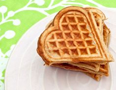 Get your lovely morning off to the right start with a batch of delicious and nutritious cinnamon oatmeal waffles in the special shape of a heart.