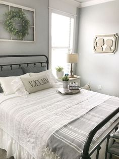 Farmhouse Bedding. Bedroom with farmhouse inspired bedding. Neutral Farmhouse Bedding. Farmhouse Bedding is from Pottery Barn. Farmhouse Bedding #FarmhouseBedding #neutralbedding #bedding Beautiful Homes of Instagram /ourvintagenest/