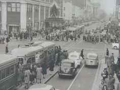 Capital Transit PCCs on F Street, NW. Woodward & Lothrop department store in background (1940s).