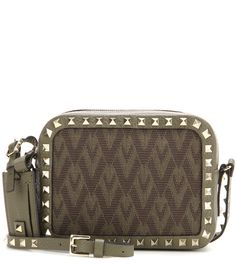 Valentino - Rockstud leather and jacquard cross-body bag - Valentino's signature 'Rockstud' cross-body bag gets a retro update with the brand's 'Viva Valentino' jacquard print. Tap into the military trend with the army-green hue and let the standout design prove a statement finishing touch to high-drama and low-key looks alike. seen @ www.mytheresa.com