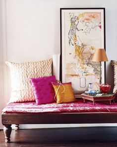 Divan placed for a casual reading/lounging nook.  Love the bright fabric  on cushions.