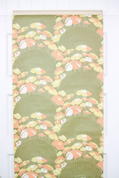 This might be one of my current favorites! Love the orane and yellow daisies on a scalloped green design. Find this paper in our Etsy store, Retro Wallpaper, along with many other great 70s and 60s patterns.