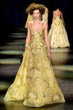 Vibrant gold gown at Naeem Khan: http://www.stylemepretty.com/2016/02/18/new-york-fashion-week-dresses-fall-2016/