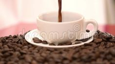Pouring coffee into cup slow motion