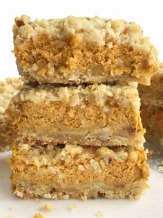 Pumpkin pie crumble bars tastes just like pumpkin pie but in bar form! A brown sugar, oat, pecan crumble with a sweet and creamy pumpkin cheesecake middle. These bars are one of our favorite pumpkin desserts. They are a must-make. Pumpkin Squares, Pumpkin Bars, Pumpkin Dessert, Vegan Pumpkin, Pumpkin Cookies, Pumpkin Spice, Fall Desserts, Delicious Desserts, Dessert Recipes