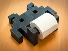 This is a printed toilet paper holder. It's shaped like a Space Invaders, the . Read more Space Invaders Toilet Paper Holder