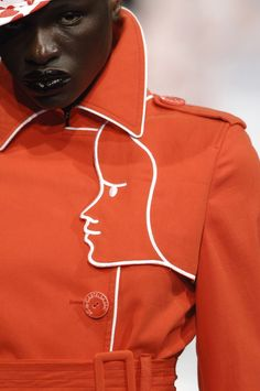 Jean-Charles de Castelbajac S/S 2007. Orange trench coat. Lapel detail.