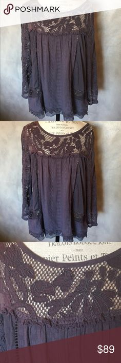 Host Pick Gorgeous Anthropologie lace tunic Truly stunning Anthropologie top with cotton lace.  It looks dark gray but does have a nice purple undertone.  Can be dressed up or down. Perfect with denim or a boho chic floral skirt. Anything plain will look great with it. Very comfy and feels light weight. Top base is 100% cotton. Size XL. I love it but need to sell since it's too big for me. Worn very few times like new. Anthropologie Tops Tunics