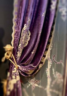 Aubergine and gold drapes