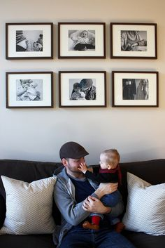 love the black & white baby/family photos framed above couch