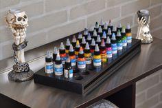 This is the color rack. Tattoo Shop Decor, Tatto Shop, Tattoo Studio Interior, Tattoo Station, Barber Tattoo, Small Flower Tattoos, Tattoo Equipment, Inked Shop, Tattoo Parlors