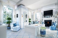 bathroom lounges In the master bathroom of Patricia Altschul's South Carolina mansion, decorator Mario Buatta concealed the toilet in a tall chinoiserie cabinet; a Manuel Canovas print covers the slipper chair at left, a Brunschwig & Fils fabric was used on the chair at right, and the garden stool is from John Rosselli Antiques.