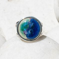 Sterling silver double shank ring with a distinctive round form cobalt blue waves with shades of mauve splashing into green