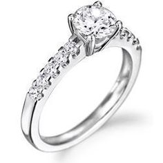 The perfect engagement ring! White gold band, large set circular diamond w/ tapering baguettes.