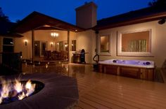 deck with hottub and firepit