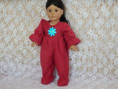 Soft, snuggly one piece Red Fleece Footie Pajamas    with Blue Flower made to fit 18 or American Girl doll. Closes in the back with Velcro.