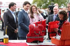 Kate is presented with personalised jackets for Prince George and Princess Charlotte at the Kitsilano Coast Guard Station