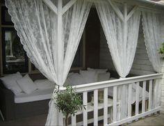 Cozy veranda with lacy white curtains - via Welke