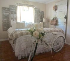 Junk Chic Cottage: Update on Guest Room and New Treasures - wow, the shutters/window for a headboard is amazing!